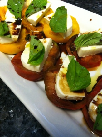 Caprese salad - best summer snack or appetizer - heirloom tomatoes, mozzarella, fresh basil, olive oil, and balsamic vinegar